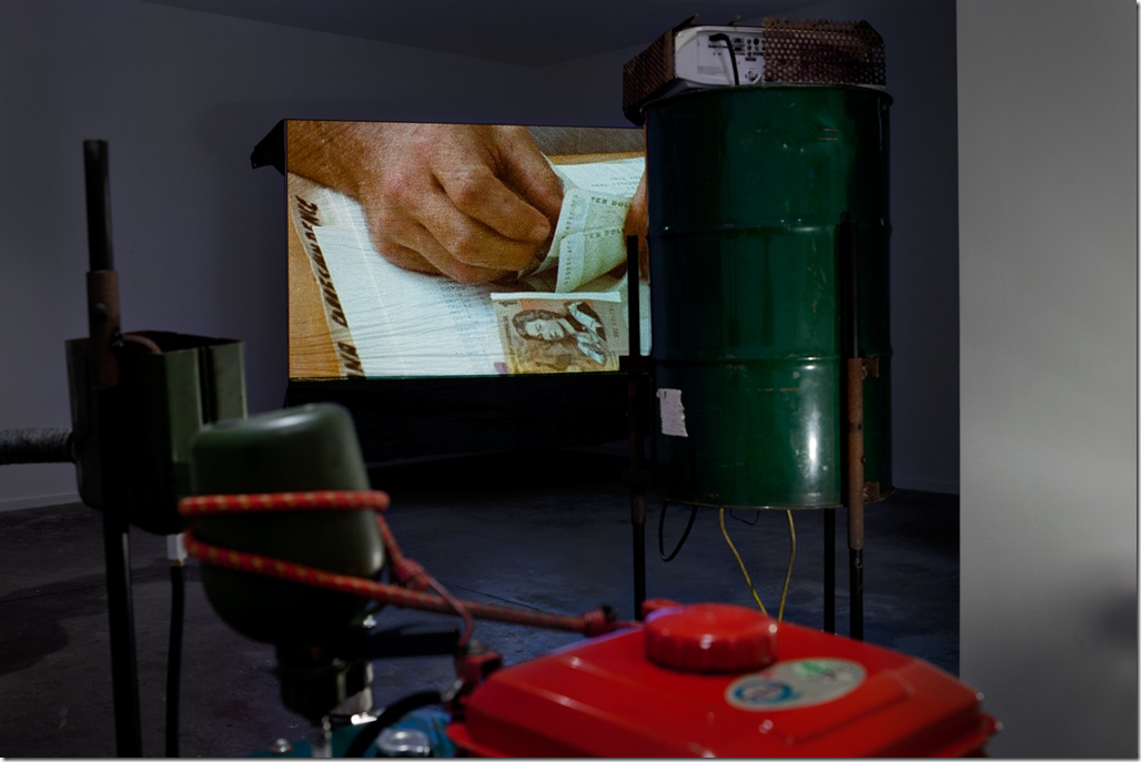 Installation shot from Nicholas Mangan 'Progress in Action' Sutton Gallery 2013